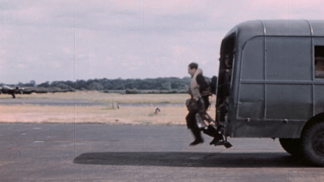 ts raf bomb crews wearing flak vests disembarking military bus and walking to lancaster bomber on flightline / england united kingdom - lancaster bomber stock videos & royalty-free footage