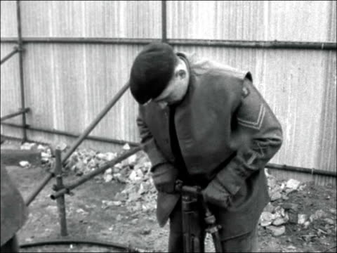 bomb disposal unit working at site where unexploded bomb was found england london surrey docks ext sign keep clear unexploded bomb as soldiers from... - sleeve stock videos & royalty-free footage