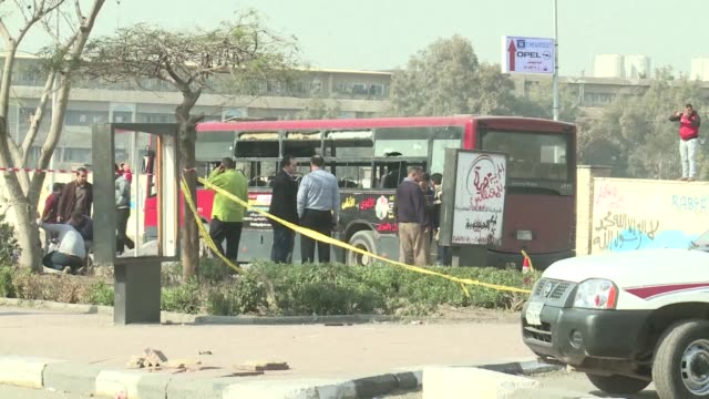 a bomb exploded near a bus in cairo thursday injuring five people a day after the government widened a crackdown on islamists by declaring the muslim... - veicolo terrestre commerciale video stock e b–roll