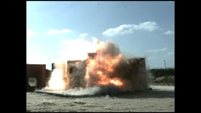 a bomb explodes inside a structure. - esplosivo video stock e b–roll