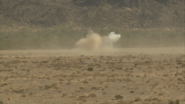 a bomb explodes near a missile truck. - esplosivo video stock e b–roll