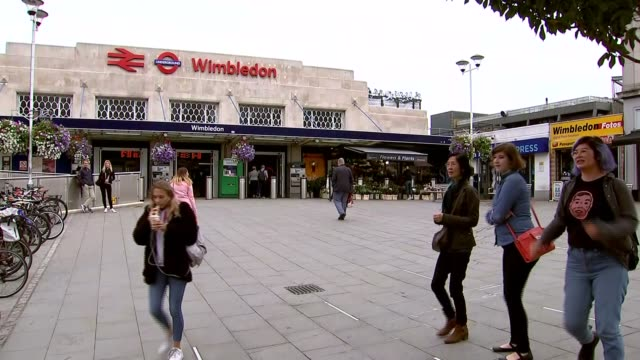 Bomb explodes on Tube train at Parsons Green District Line stations closed Various shots of Wimbledon station including passengers to and fro at...