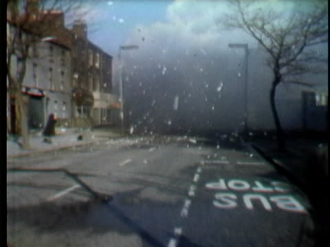 bomb explodes outside of the balmoral furniture company on shankill road in belfast, northern ireland. the powerful blast collapsed the building,... - irlanda del nord video stock e b–roll