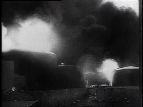 bomb explosions on a street / bomber flying in the sky / smoke from a bomb explosion / bomb falling / buildings collapsing - bombenanschlag stock-videos und b-roll-filmmaterial