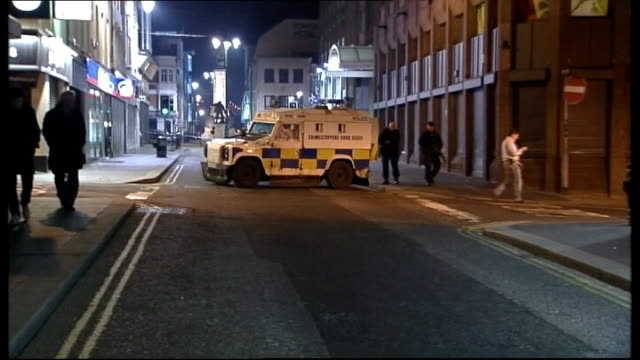 bomb planted outside courthouse in northern ireland northern irleand londonderry armed police officer walking down street bomb disposal team at scene... - disposal stock videos and b-roll footage