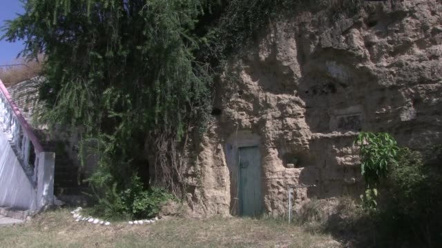 bomb proof earthquake resistant and cheap: thousands of pakistanis are choosing to hunker down in caves northwest of islamabad snapping up the hobbit... - the hobbit stock videos & royalty-free footage