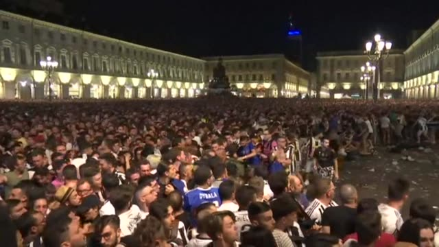 bomb scare triggers panic among juventus fans assembled to watch the champions league final in turin leaving some 30 supporters injured afp reporters... - fan video stock e b–roll
