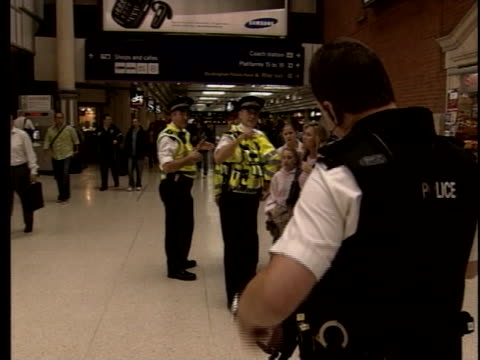 bomb squad police officers patrol the hallways in a london subway station. - underground station stock videos & royalty-free footage