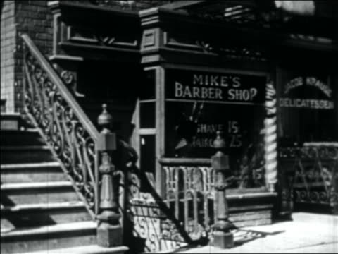 b/w 1934 bomb thrown thru window of barber shop which then explodes - bomb stock videos & royalty-free footage