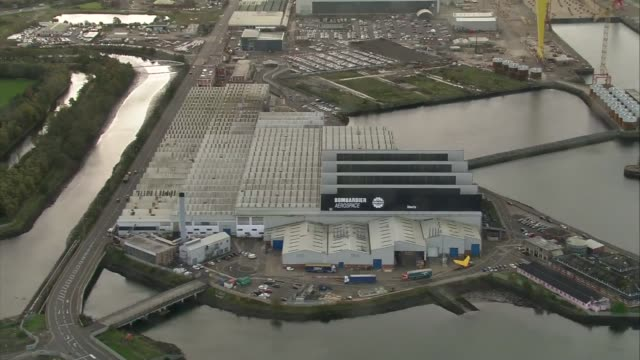 bombardier and stormont aerials; northern ireland: belfast: ext air views / aerials belfast dockyard area and bombardier aerospace factory / stormont... - belfast stock videos & royalty-free footage
