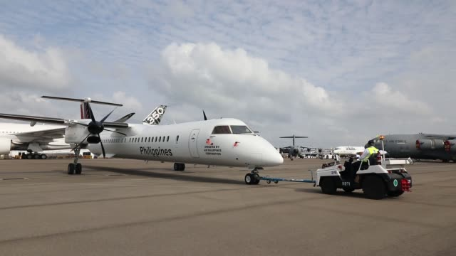 A Bombardier Inc Q400 passenger aircraft operated by Philippine Airlines Inc is towed during a media preview day at the Singapore Airshow held at the...