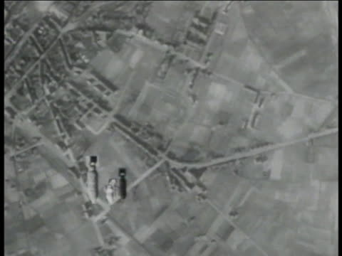 Bombardier sighting AERIAL B17 dropping bombs TD OVER Bombs falling bombs hitting ground explosion fire CAMERA SHAKE TD OVER Bombs falling down into...