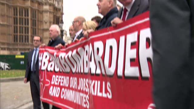 Bombardier workers and MPs photoop outside parliament ENGLAND London Houses of Parliament EXT Bombardier workers and MPs photocall outside Houses of...