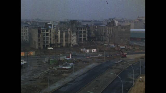 has bomb-damaged buildings in east berlin; 1969 - establishing shot stock videos & royalty-free footage