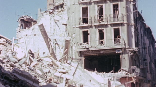 bombed buildings and debris in town / france - 礎石点の映像素材/bロール