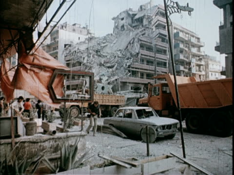 bombed out buildings in beirut after heavy fighting people screaming and crying / soviet propaganda film about the 1982 lebanon war - beirut stock videos & royalty-free footage