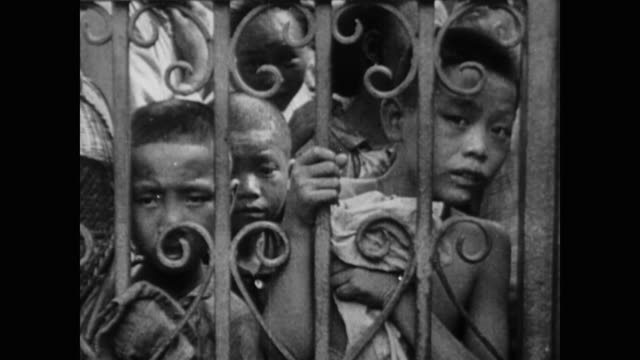 bombed out civilians in shanghai take refuge in the international quarter while the thousands locked out face the terror of panicked crowds and fiery... - 1937 stock videos & royalty-free footage