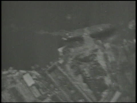 s bomber aircrafts firing on japanese harbors shipping installations us fighter airplanes amp bomber aircrafts including partial curtis helldiver... - 1940~1949年点の映像素材/bロール