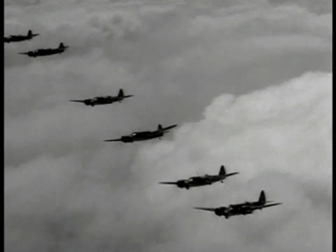 vidéos et rushes de bomber airplanes flying over clouds ms blenheim iv bomber flying la raf pilot in cockpit navigator w/ headphones map cu map of bremen la xws missile... - 1941