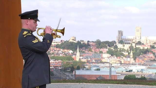 bomber command memorial spire unveiled in lincoln bugler plays last post at bomber command memorial spire unveiling ceremony lincoln cathedral in... - リンカンシャー点の映像素材/bロール