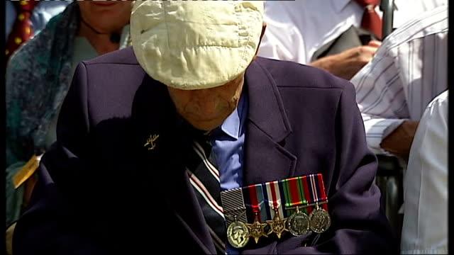 vídeos de stock, filmes e b-roll de bomber command war memorial unveiled by the queen england london green park veteran wiping away a tear veteran sat at ceremony to unveil memorial... - parque green