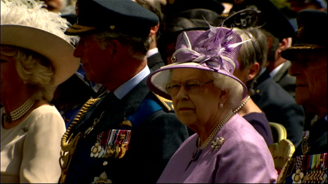 bomber command war memorial unveiled by the queen; sir robert wright reading sot / sir steven dalton speech sot / clergy prayer sot / flypast... - bomber stock videos & royalty-free footage
