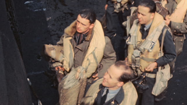ts raf bomber crew wearing flak vests and carrying parachutes loading gear aboard lancaster / england united kingdom - lancaster bomber stock videos & royalty-free footage