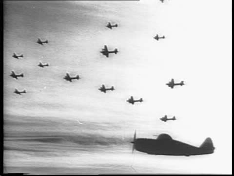 bomber flying close to ground / plane crash lands in a wheat field, explosion in distance as soldiers in foreground watch / black smoke and fire,... - bomber stock videos & royalty-free footage