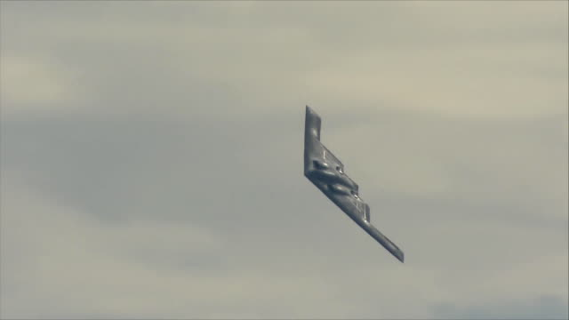 b-2 bomber flying in the sky - bomber plane stock videos and b-roll footage
