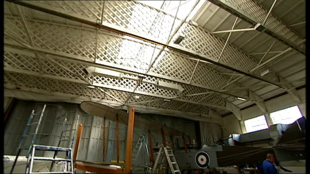 stockvideo's en b-roll-footage met dh9 bomber goes on display at imperial war museum in duxford dh9 biplane being worked on in aircraft hangar - imperial war museum museum