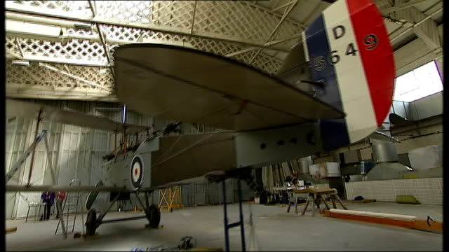 stockvideo's en b-roll-footage met dh9 bomber goes on display at imperial war museum in duxford england cambridgeshire duxford imperial war museum forward through aircraft hangar to... - imperial war museum museum