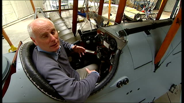 stockvideo's en b-roll-footage met dh9 bomber goes on display at imperial war museum in duxford salvaged parts of plane including engine and lewis gun glass climbing into cockpit... - imperial war museum museum