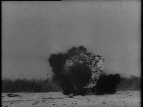 bomber plane dropping bombs / bombs exploding on the ground / bombs falling in the sky / explosion on the ground