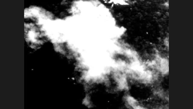 us bomber planes drop bombs on vietnam / aerial of bombs exploding through the jungle / dropped bombs explode in a river / plane flying above the... - vietnamkrieg stock-videos und b-roll-filmmaterial