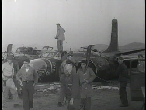 b26 bomber preforms a successful crash landing after sustaining damage during battle / emergency crews and vehicles rush to the bomber as its crew... - bomber plane stock videos and b-roll footage