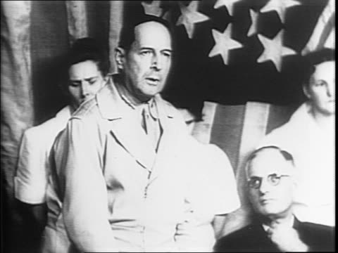Bomber rolling along runway / General Douglas MacArthur exits plane shakes hands with Australian Prime Minister John Curtin / MacArthur walking...