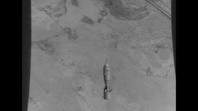 bombers flying in formation overhead / shot from bomber of bomber dropping bombs, other bombers in background / aerial shot of bombs exploding in... - world war ii video stock e b–roll