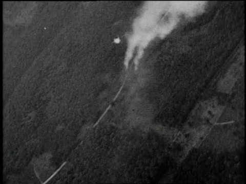 bombers flying / smoke from bombs billowing up from ground / bombers flying in formation / bomb dropping to ground and exploding - luftwaffe stock-videos und b-roll-filmmaterial