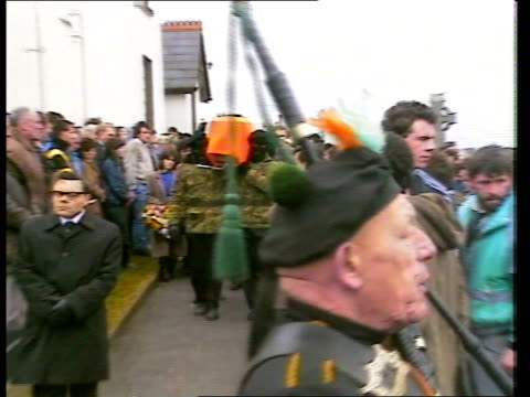 bombers' funerals south armagh crossmaglen 5388 cms policeman in riot gear past as apcs and more riot police in b/g ms apcs as crowd of mourners... - mourner stock videos and b-roll footage