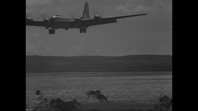 VS bombers in air landing taxi on runway / VS United States Army soldiers Navy Seabees watch planes arrive land / VS Brigadier General Haywood...