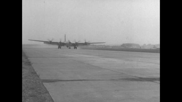 wv us bombers lined up at japanese airfield during korean war / three fire trucks pull out / bomber rolls past camera after landing / bomber taxis... - luftwaffe stock-videos und b-roll-filmmaterial