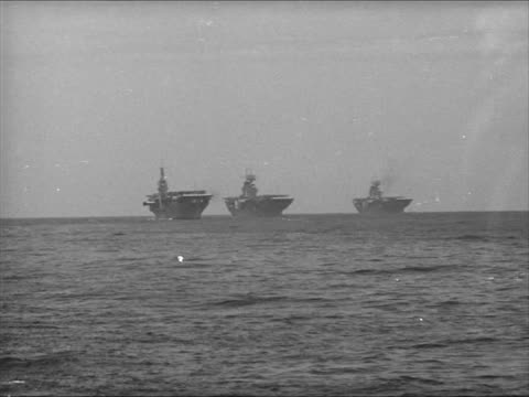 Bombers releasing torpedoes XWS Three Aircraft Carriers INT Communications Center on Battleship Man dollies torpedo on deck AntiAircraft guns on deck...