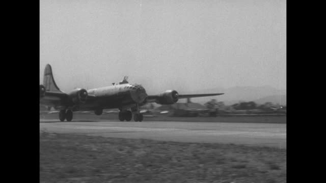 bombers take off from airfield in japan during korean war / shot of bomber in air from another bomber / aerial shot of countryside below / plane... - luftwaffe stock-videos und b-roll-filmmaterial