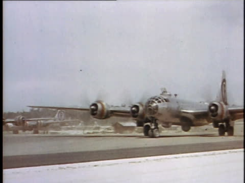 b29 bombers taxi on runway before takeoff / tinian mariana islands - air vehicle stock videos & royalty-free footage