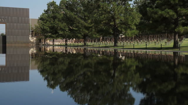 okc bombing memorial reflecting pool and field of empty chairs - 1995 stock videos & royalty-free footage