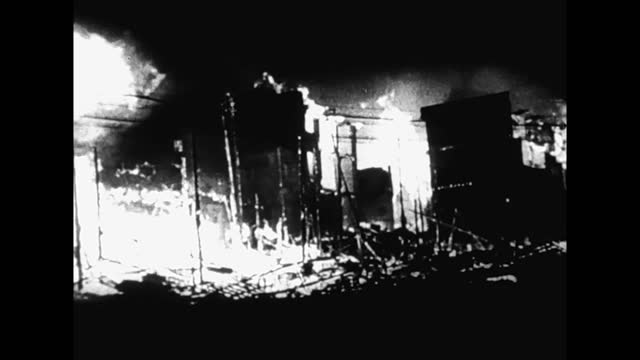 vídeos de stock, filmes e b-roll de bombing of chongking aftermath: people fighting with fire after air raid - air raid