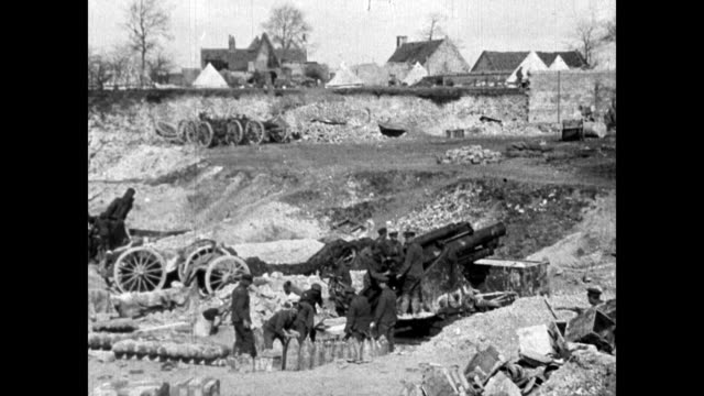 LS of bombing of German wire entanglements / LSs of explosions of shelling of captured village by enemy of 92' Howitzers firing