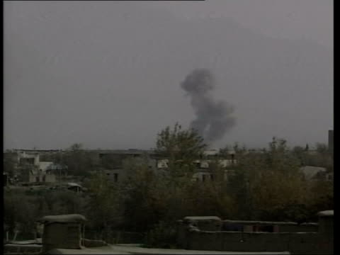 vídeos de stock e filmes b-roll de bombing roundup itn ground to air us fighter jet over and drops bomb lms bomb exploding at distant bagram airbase ground to air us fighter jet in... - ataque aéreo