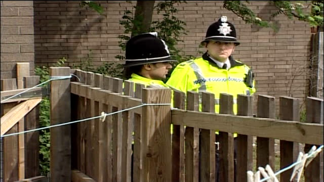 4 arrested including widow of ringleader batley police officers standing guard outside house - widow stock videos & royalty-free footage