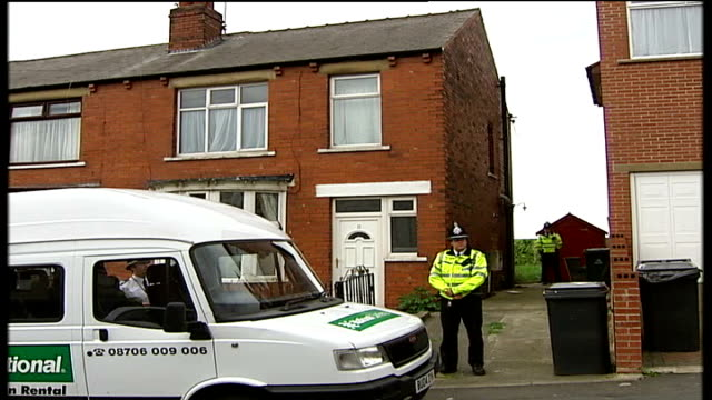 4 arrested including widow of ringleader england yorkshire ext police officers guarding houses where antiterror raid took place and four people... - barry took stock-videos und b-roll-filmmaterial